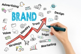 Brand Business Concept. Hand with marker writing (© tumsasedgars / Fotolia.com)