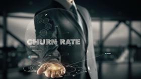 Churn Rate with hologram businessman concept (© ankabala / Fotolia.com)